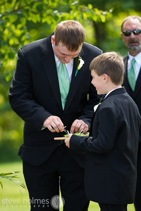 Best man and ring bearer present the rings.
