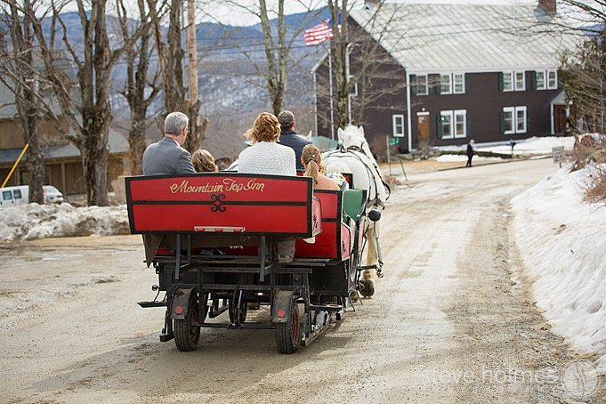 The bride, bridesmaids and father being delivered to the ceremony by horse drawn carriage at The Mountain Top Inn & Resort.