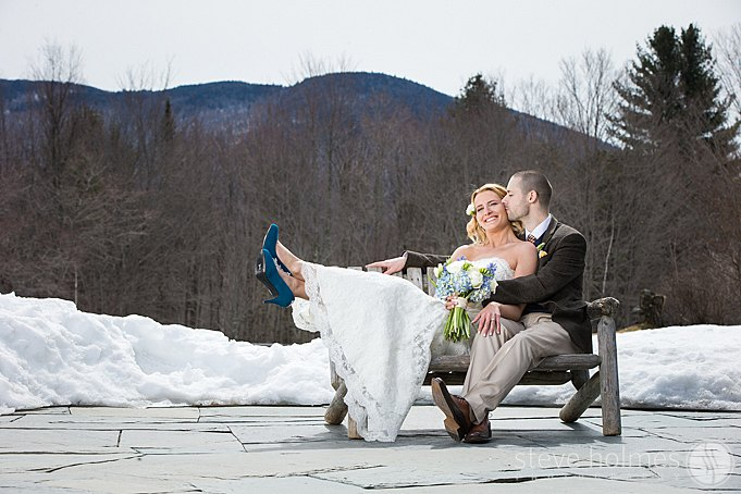 A portrait of the couple with beautiful mountains in the background.