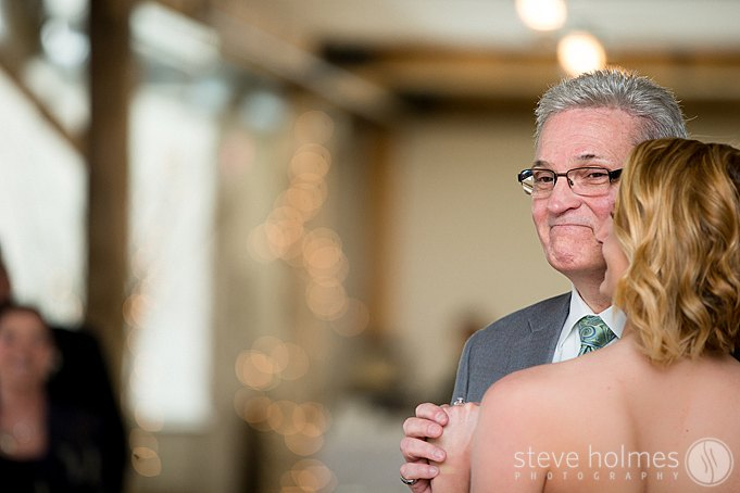 A proud moment for the father of the bride during their dance.