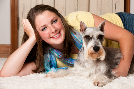 Senior portrait of a high school girl and her dog.