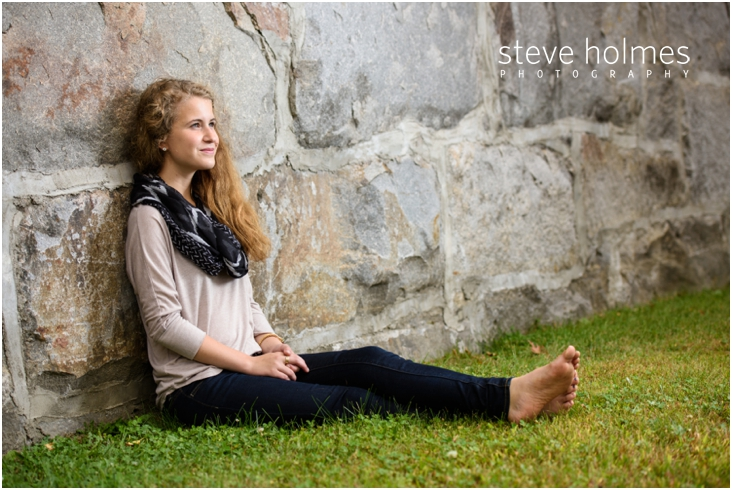 4_girl-leaning-up-against-rock-wall-for-senior-portraits