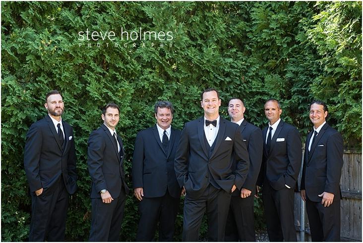 10_groom-groomsmen-standing-outside-smiling
