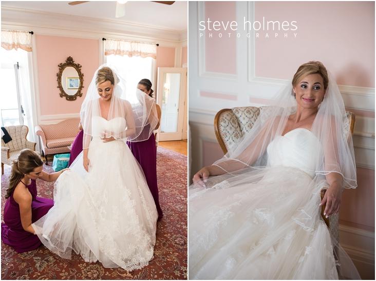 14_bridesmaids-help-bride-get-into-dress