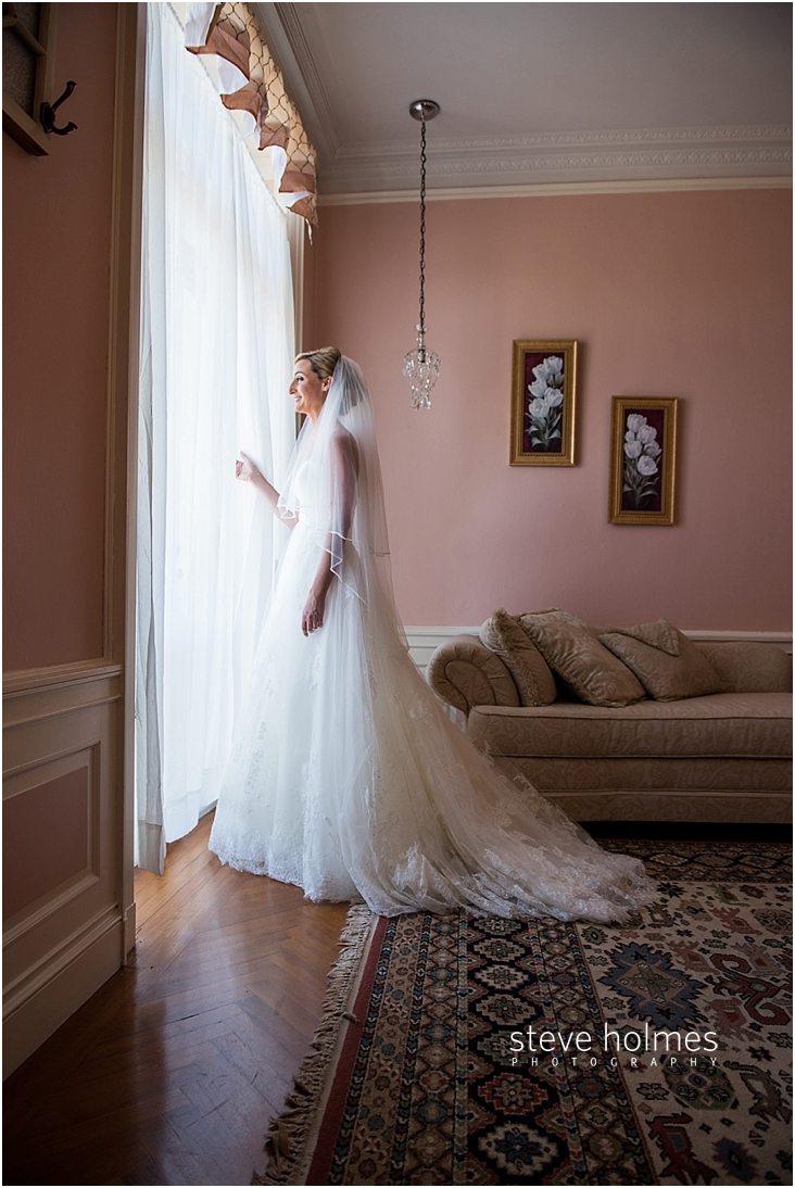 18_smiling-bride-looks-out-window
