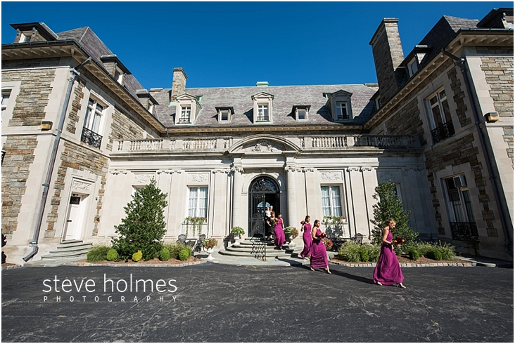 30_bridesmaids-walk-out-of-mansion