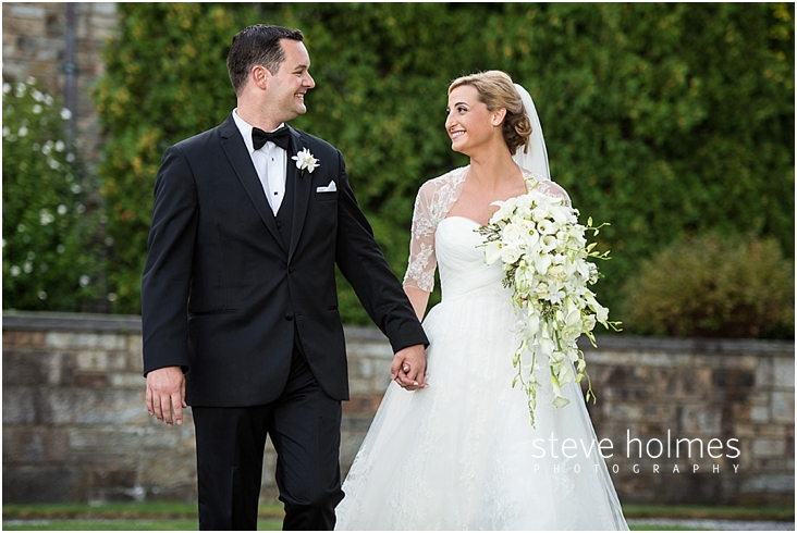 48_bride-and-groom-smiling-at-each-other-as-they-hold-hands