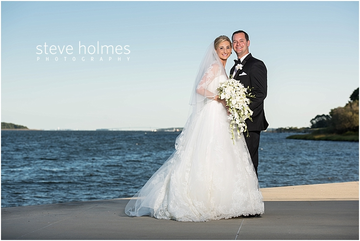 52_bride-and-groom-standing-by-lake