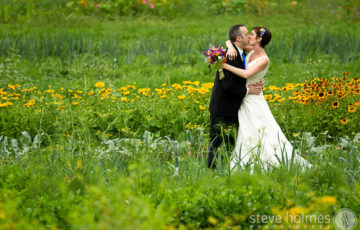 Bride and Groom kiss in garden at Stonewall Farm
