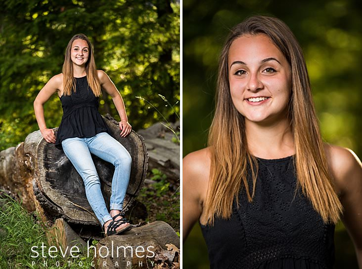 19_Young woman leans against giant log for outdoor senior portrait.jpg