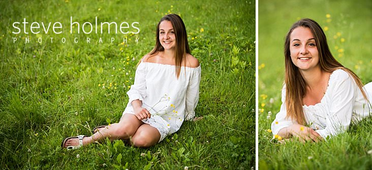 32_Young woman wearing white dress sits in a field of wildflowers.jpg