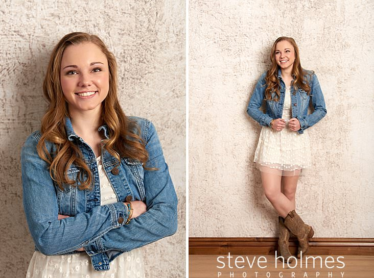 02_Teenaged girl wearing jean jacket and white dress smiles with arms folded across chest for studio senior portrait.jpg