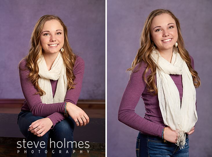 04_Teen girl wearing purple long sleeve, jeans and a scarf sits and smiles for studio senior portrait.jpg