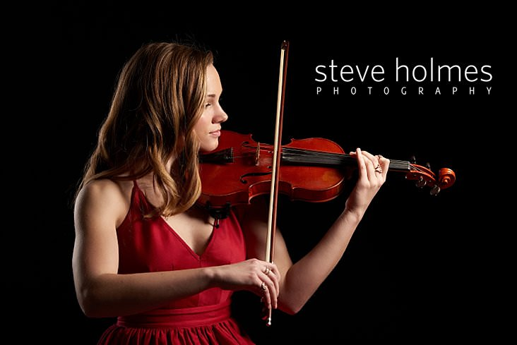 06_Young woman wearing red dress poses for studio senior portrait with violin_.jpg