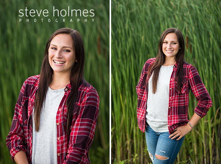 07_Brunette teen wearing red flannel shirt laughs in outdoor senior portrait.jpg