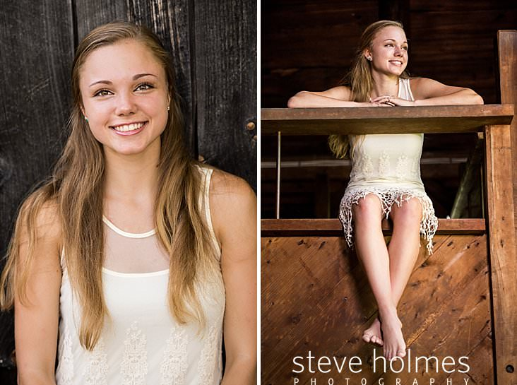 18_Teen girl wearing lace dress poses for senior photo in front of barn.jpg