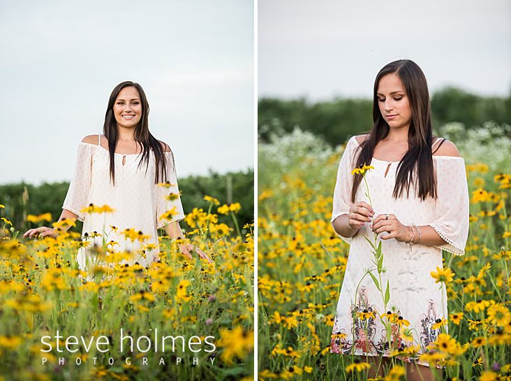 19_Senior portrait of brunette girl walking through wildflowers.jpg