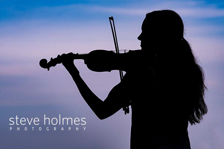 22_Silhouette of teen playing violin against sunset sky.jpg