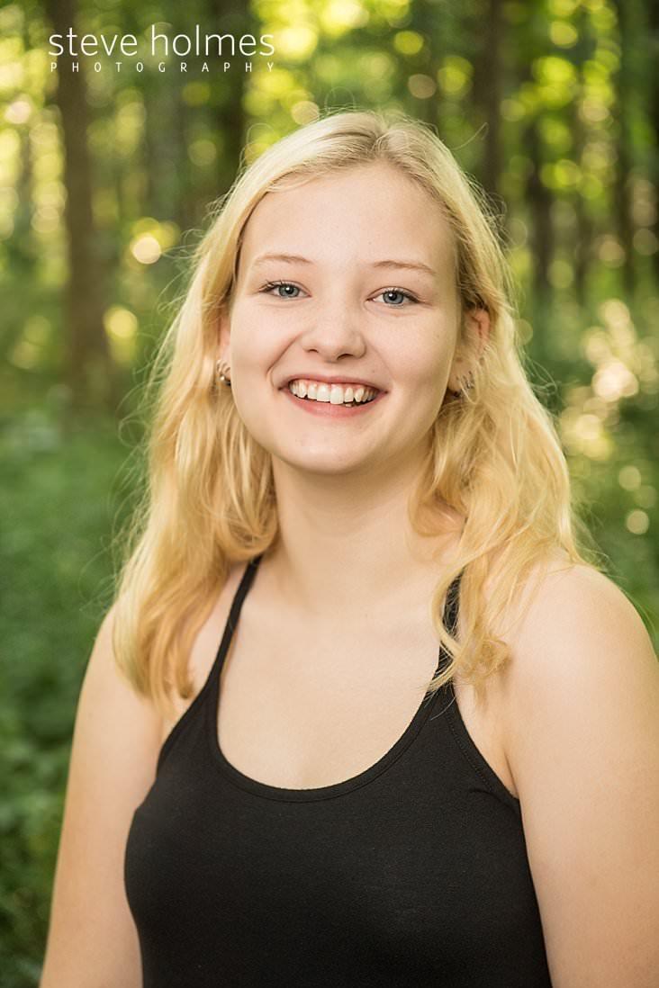 05_Blonde teen laughs in outdoor senior portrait.jpg