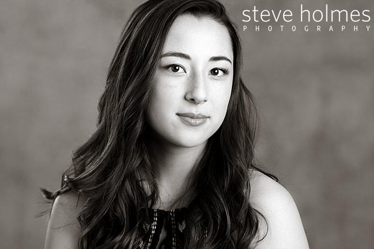 01_Black and white studio senior portrait of teen girl with wavy long hair.jpg