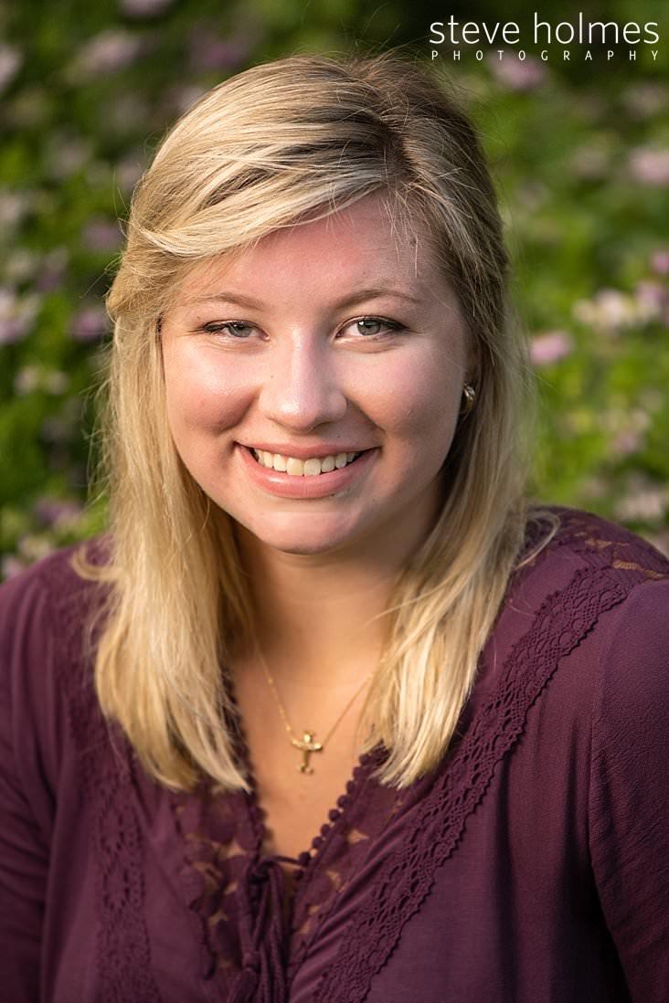 11_Blonde teen smiles for outdoor senior portrait.jpg
