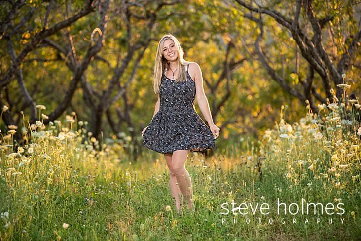 22_Blonde teen poses in summer orchard for senior portrait.jpg