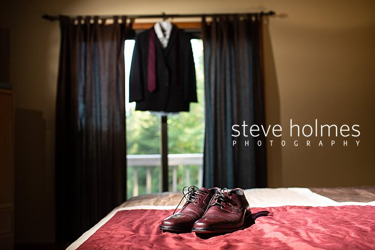 02_Groom's shoes are laid out with suit hanging in background.jpg