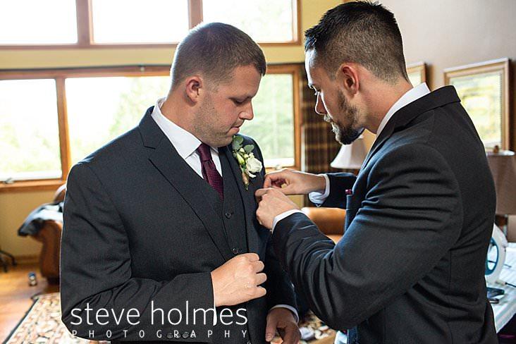 06_Groomsman helps groom with pocket square.jpg