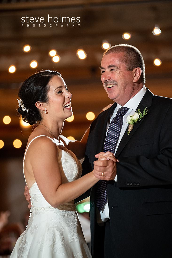 71_Bride laughs with her father during dance.jpg